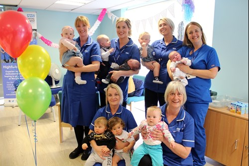 Highfield Midwives celebrate with some of the babies that they have delivered.